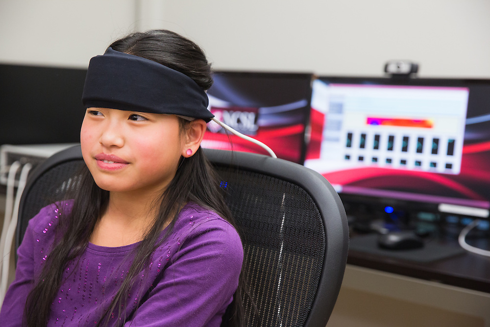 Kate Maxwell, 12, a sixth-grade student at Sunnyside Elementary in Pullman, Wash., is asked a series of questions while wearing a Functional Near Infrared Spectroscopy device during a field trip to the Washington State University neurocognition sciene lab Monday, Feb. 22, 2016.