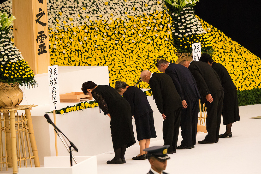 TOKYO, JAPAN - AUGUST 15 : People bow after offering flowers to pay respects during the memorial service at the Nippon Budokan on the 71st anniversary of the Japan's war surrender on August 15, 2016 in Tokyo, Japan. (Photo by Richard Atrero de Guzman/NURPhoto)