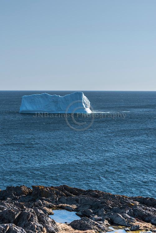 Torbay iceberg has flipped after pieces have broken off.  Newfoundland Labrador, Canada