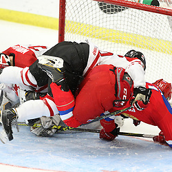 COBOURG, - Dec 19, 2015 -  Gold Metal Game - Russia vs Canada West at the 2015 World Junior A Challenge at the Cobourg Community Centre, ON. Brandon Biro #16 of Team Canada West protects the crease during the third period.(Photo: Tim Bates / OJHL Images)