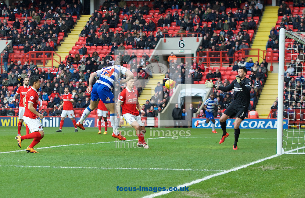 Yann Kermorgant of Reading scores the opening goal with a header past goalkeeper Stephen Henderson of Charlton Athletic during the Sky Bet Championship match at The Valley, London<br /> Picture by Alan Stanford/Focus Images Ltd +44 7915 056117<br /> 27/02/2016