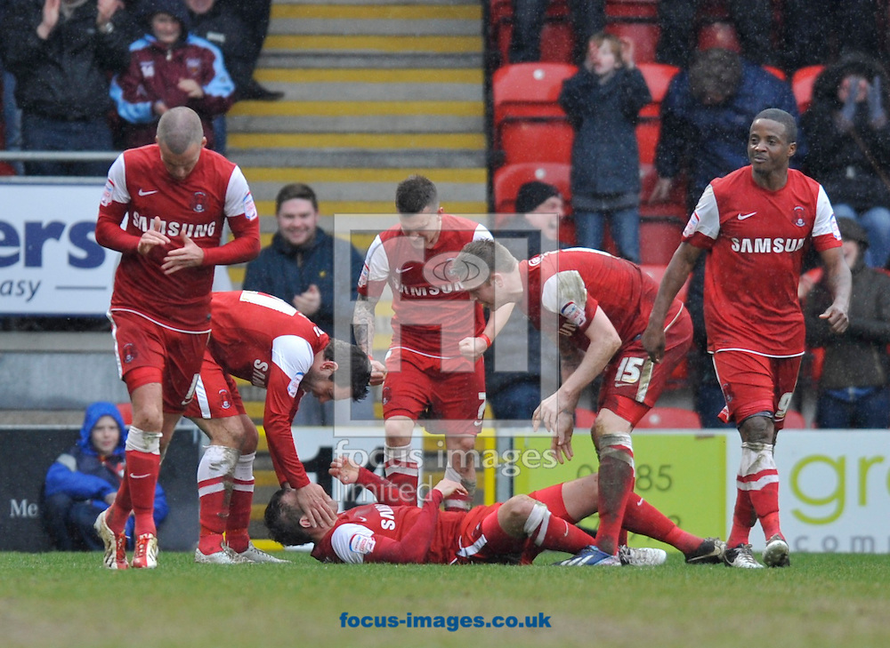 Picture by Alan Stanford/Focus Images Ltd +44 7915 056117.20/04/2013.Gary Sawyer of Leyton Orient  is congratulated on his goal by his team matesduring the npower League 1 match at the Matchroom Stadium, London.