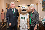 OHIO President and First Lady Nellis pose for a photo with  Rufus at Cutler Hall.