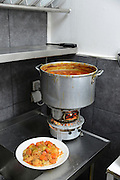 A plate of Vegetable couscous next to the cooker