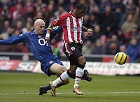 Photo: Alan Crowhurst, Digitalsport<br /> Southampton v Arsenal, 26/02/2005, Barclays Premiership. Arsenal's Pascal Cygan makes a challenge on Henri Camara.