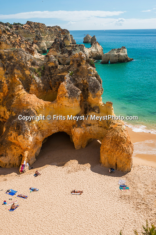 Alvor, Algarve, Portugal, October 2014. Praia dos Tres Irmaos.  A spectacular coastline of steep sandstone cliffs borders hidden sandy beaches on the south western tip of Europe, where the Mediterranean becomes the Atlantic Ocean.  Photo by Frits Meyst / MeystPhoto.com