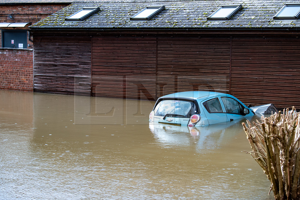 © Licensed to London News Pictures. 26/02/2020. Ironbridge, UK. A car sits in water in Ironbridge as flood defences were breached on part of the River Severn as levels continued to rise police evacuated part of the town. Photo credit: Peter Manning/LNP