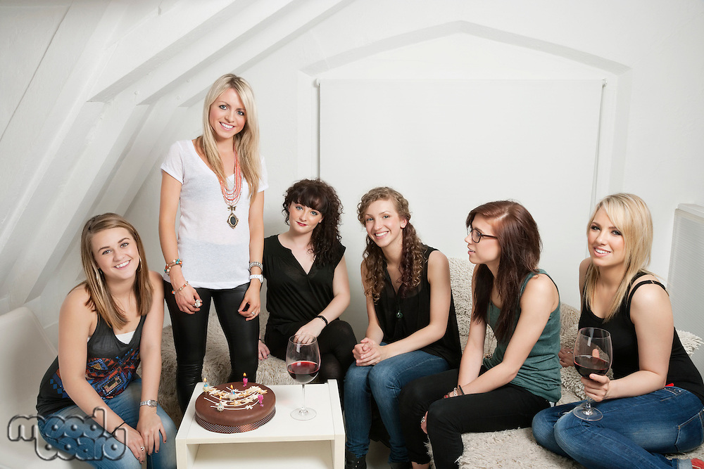 Female friends celebrating young woman's birthday