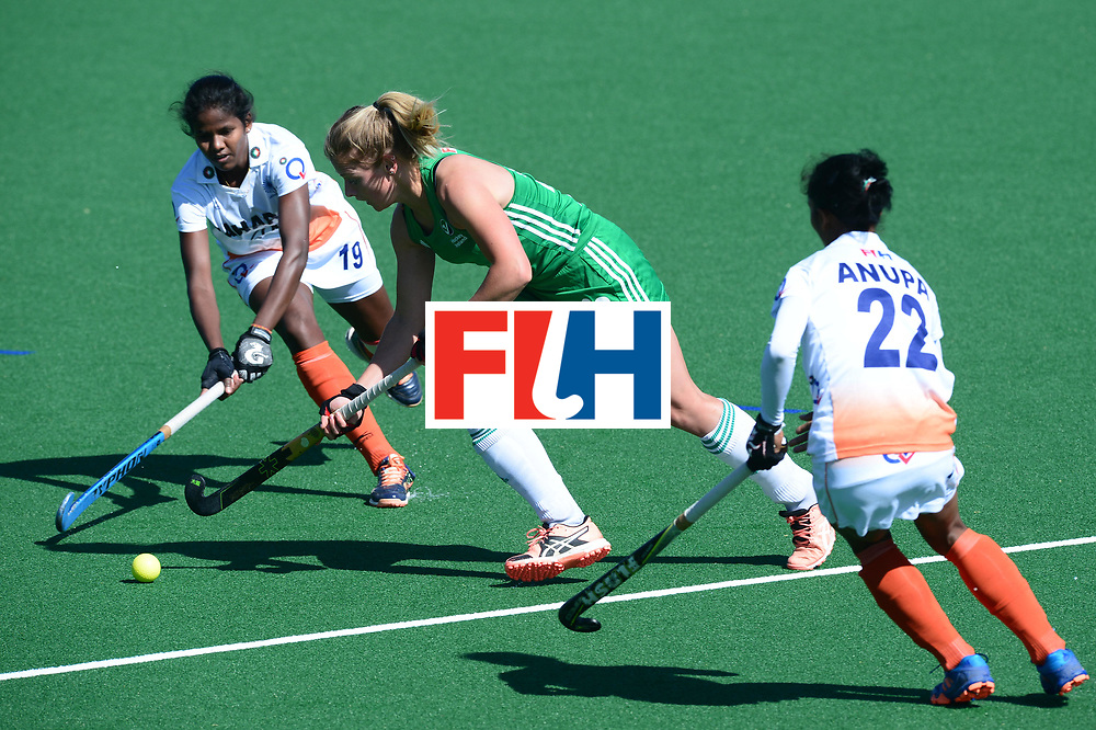 JOHANNESBURG, SOUTH AFRICA - JULY 22: Namita Toppo of India tackles Chloe Wathins of Ireland during day 8 of the FIH Hockey World League Women's Semi Finals 7th-8th place match between India and Ireland at Wits University on July 22, 2017 in Johannesburg, South Africa. (Photo by Getty Images/Getty Images)