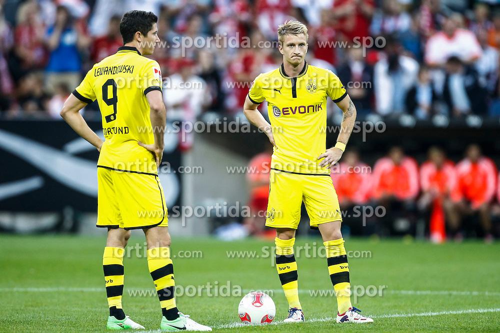 Football: Germany, Supercup 2012, FC Bayern Munich - BVB Borussia Dortmund, Muenchen, 12.08.2012.Robert Lewandowski (l.) and Marco Reuss (BVB) looks dejecetd.© pixathlon