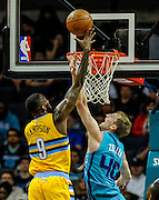 Denver Nuggets guard JaKarr Sampson (9) shoots against Charlotte Hornets' Cody Zeller (40) during the first half of an NBA basketball game in Charlotte, N.C., Saturday, March 19, 2016. (AP Photo/Mike McCarn)