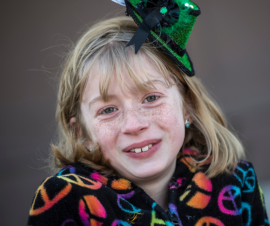 9 year old Kendra Dobberstein of Rosendale, waits with family for the St. Patrick's Day parade to start in downtown Fond du Lac. Saturday, March 17, 2018, Patrick Flood Photography