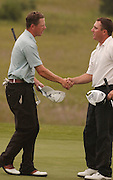 2006 Tournament of Champions winner Michael Harris (left) shakes hands with second place finisher Eric Jorgensen (right) on final hole of the event at Boyne Mountain.