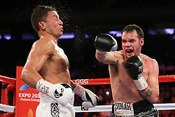 NEW YORK, NY - JULY 26: Gennady Golovkin (white trunks) takes a right hand from Daniel Geale (silver/black trunks) during their WBA/IBO Middleweight World Championship bout at Madison Square Garden on July 26, 2014 in New York, New York. (Photo by Ed Mulholland/K2 Promotions)