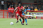 David Sesay and George Lloyd   during the EFL Sky Bet League 2 match between Crawley Town and Cheltenham Town at The People's Pension Stadium, Crawley, England on 31 August 2019.