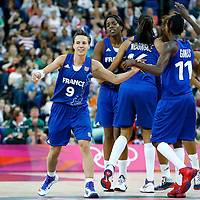 09 August 2012: France Celine Dumerc celebrates with her teammates during 81-64 Team France victory over Team Russia, during the women's basketball semi-finals, at the 02 Arena, in London, Great Britain.