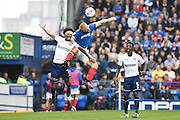 Wycombe Wanderers defender Sido Jombati (2), battles in the air with Portsmouth forward Curtis Main (14) during the EFL Sky Bet League 2 match between Portsmouth and Wycombe Wanderers at Fratton Park, Portsmouth, England on 10 September 2016. Photo by David Charbit.