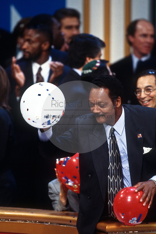 Rev. Jesse Jackson throws balloons at the close of the 1996 Democratic National Convention August 29, 1996 in Chicago, IL.