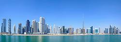 Daytime view of Burj Khalifa and Creek at new Business Bay district of  Dubai United Arab Emirates