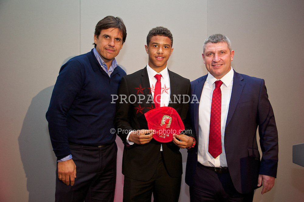 CHEPSTOW, WALES - Saturday, May 24, 2014: Tyler Roberts is presented with his Wales Under-16's cap by Senior mens' team manager Chris Coleman and coach Osian Roberts at the St. Pierre Marriott Hotel & Country Club. (Pic by David Rawcliffe/Propaganda)