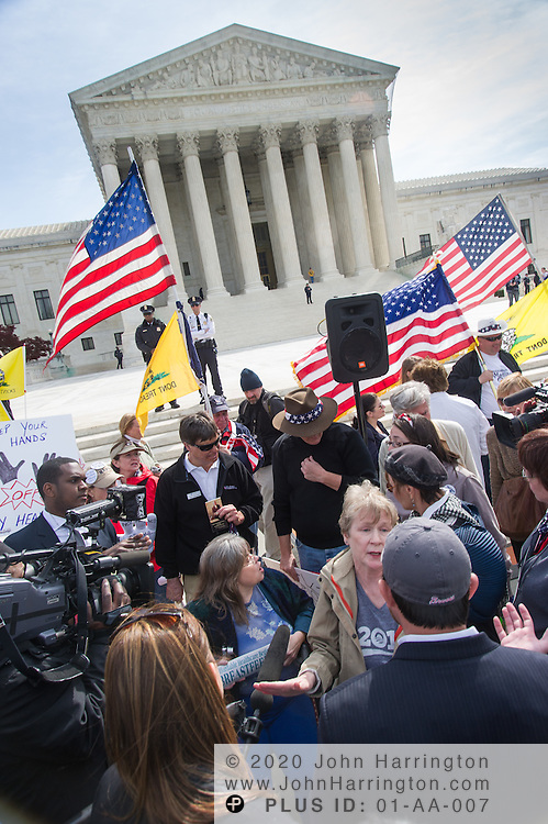 Protesters outside the Supreme Court during the justices' deliberation on the Health Care Bill on March 28th, 2012 in Washington, DC.