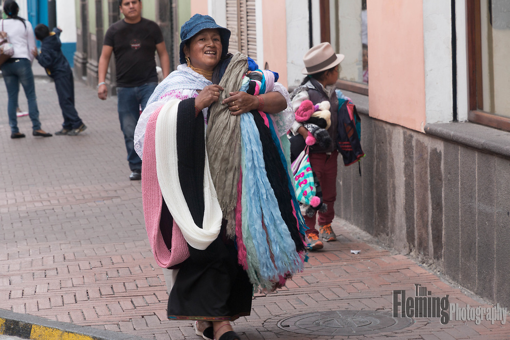 Woman selling scarves in Old Town, Quito, Ecuador