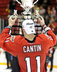 Marc Cantin hoists the Memorial Cup after the Windsor Spitfires defeated the Brandon Wheat Kings in the championship game at the 2010 MasterCard Memorial Cup in Brandon, MB on Sunday May 23. Photo by Aaron Bell/CHL Images