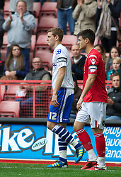 LONDON, ENGLAND - Saturday, October 8, 2011: Tranmere Rovers' Captain Ash Taylor and Charlton Athletic's Captain Johnnie Jackson lead their two sides out during the Football League One match at The Valley. (Pic by Gareth Davies/Propaganda)