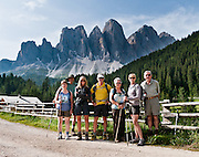 Hikers enjoy another sunny day in the Dolomites. North faces of the Geisler/Odle Group drop nearly 1000 meters into Val di Funes (Villnöß valley) in the Dolomites, Italy, Europe. Puez-Geisler Nature Park (Italian: Parco naturale Puez Odle; German: Naturpark Puez-Geisler) is in Südtirol/South Tyrol/Alto Adige, in the Dolomiti, part of the Southern Limestone Alps, Italy. The Dolomites were declared a natural World Heritage Site (2009) by UNESCO. For licensing options, please inquire.