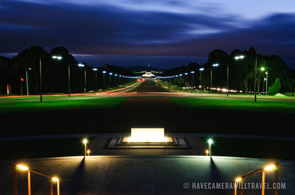 View of Canberra at night looking from steps of the Australian War Memorial back towards Old Parliament House and Parliament House over Lake Burley Griffin