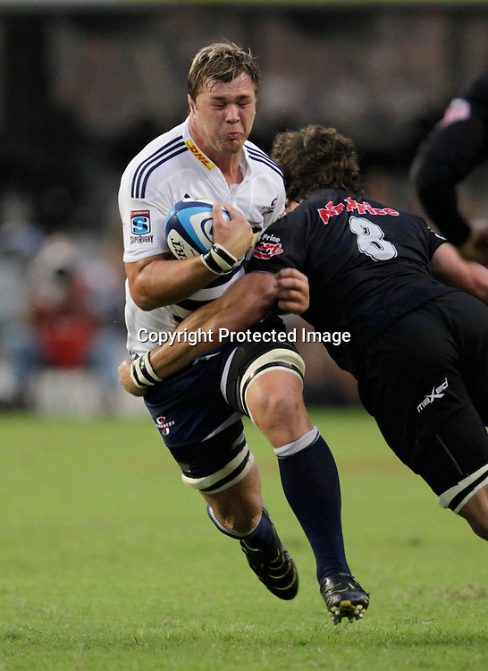 Stormers loose forward Duane Vermeulen is tackled by Sharks player Ryan Kankowski during a Super 15 rugby match in Durban, 2 April , 2011. Sportzpics