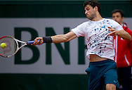 Grigor Dimitrov of Bulgaria competes in men's singles while Day Fifth during The French Open 2013 at Roland Garros Tennis Club in Paris, France.<br /> <br /> France, Paris, May 30, 2013<br /> <br /> Picture also available in RAW (NEF) or TIFF format on special request.<br /> <br /> For editorial use only. Any commercial or promotional use requires permission.<br /> <br /> Mandatory credit:<br /> Photo by © Adam Nurkiewicz / Mediasport