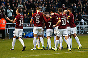 Northampton players celebrate Sam Hoskin's penalty that made it 3-0 during the EFL Sky Bet League 2 match between Northampton Town and Crewe Alexandra at the PTS Academy Stadium, Northampton, England on 16 November 2019.