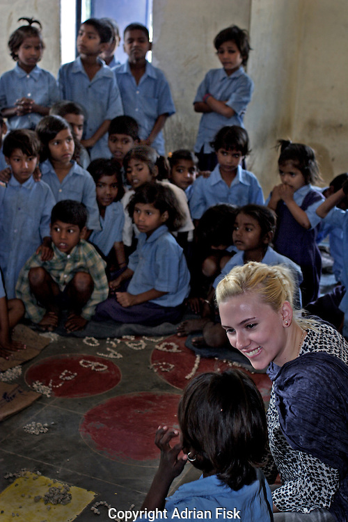 Scarlett talks with school children at the Purvaiachal dalit Balika school in Ghazipur district.