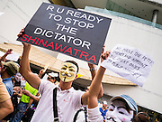 "02 JUNE 2013 - BANGKOK, THAILAND: An anti Yingluck Shinawatra protester in Bangkok. The so called White Mask protesters are strong supporters of the Thai monarchy. About 300 people wearing the Guy Fawkes mask popularized by the movie ""V for Vendetta"" and Anonymous, the hackers' group, marched through central Bangkok Sunday demanding the resignation of Prime Minister Yingluck Shinawatra. They claim that Yingluck is acting as a puppet for her brother, former Prime Minister Thaksin Shinawatra, who was deposed by a military coup in 2006 and now lives in exile in Dubai.     PHOTO BY JACK KURTZ"
