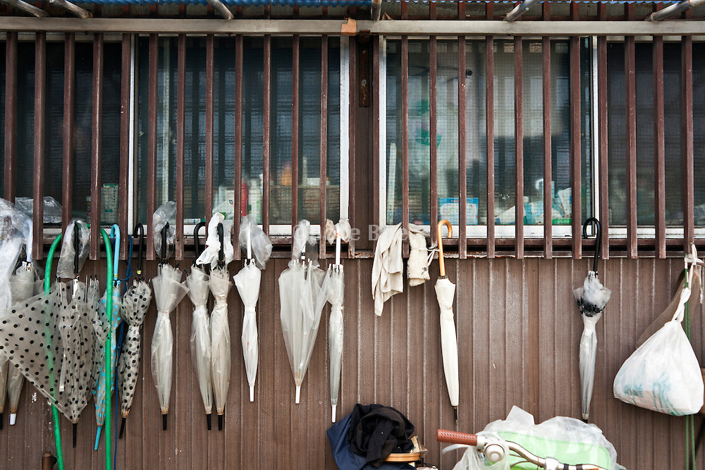 many umbrellas hanging in front of house Japan