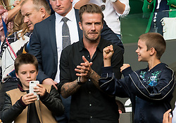 LONDON, ENGLAND - Wednesday, July 6, 2016: David Beckham and his two sons Romeo and Cruz getting excited for the start of Andy Murray's  Gentlemen's Single Quarter Finals match on day ten - of the Wimbledon Lawn Tennis Championships at the All England Lawn Tennis and Croquet Club. (Pic by Kirsten Holst/Propaganda)