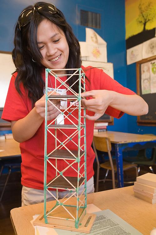 United States, Washington, Seattle, female high school student buiding tower