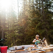 Martha Hunt working on an addition to her home in Whitefish, Montana.