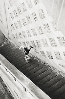 A high angle view of a young woman running up some stairs.