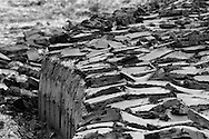 Freshly cut peat bogs on a stretch of land on the island of Lewis in the Outer Hebrides, Scotland. Peat cutting was a traditional method of gathering fuel for the winter in the sparsely-populated areas on Scotland's west coast and islands. The peat was dried and used in fires and ovens.