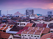 07 OCTOBER 2014 - GEORGE TOWN, PENANG, MALAYSIA: Sunset in George Town (also Georgetown), the capital of the state of Penang in Malaysia. Named after Britain's King George III, George Town is located on the north-east corner of Penang Island. The inner city has a population of 720,202 and the metropolitan area known as George Town Conurbation which consists of Penang Island, Seberang Prai, Kulim and Sungai Petani has a combined population of 2,292,394, making it the second largest metropolitan area in Malaysia. The inner city of George Town is a UNESCO World Heritage Site and one of the most popular international tourist destinations in Malaysia.         PHOTO BY JACK KURTZ