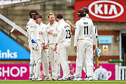 Wicket! Gareth Batty of Surrey and Ben Foakes of Surrey celebrate taking the wicket of Jeetan Patel of Warwickshire during the Specsavers County Champ Div 1 match between Surrey County Cricket Club and Warwickshire County Cricket Club at the Kia Oval, Kennington, United Kingdom on 26 June 2019.
