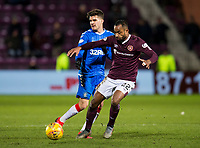 Football - 2019 / 2020 William Hill Scottish Cup - Quarter-Final: Heart of Midlothian vs. Rangers<br /> <br /> Ianis Hagi of Rangers vies with Loic Damour of Hearts, at Tynecastle Park, Edinburgh.<br /> <br /> COLORSPORT/BRUCE WHITE