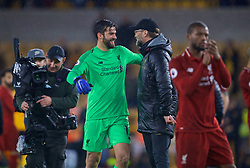 WOLVERHAMPTON, ENGLAND - Friday, December 21, 2018: Liverpool's goalkeeper Alisson Becker and manager Jürgen Klopp embrace after the FA Premier League match between Wolverhampton Wanderers FC and Liverpool FC at Molineux Stadium. Liverpool won 2-0. (Pic by David Rawcliffe/Propaganda)