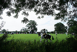 © Licensed to London News Pictures. <br /> 29/07/2014. <br /> <br /> Kirkbymoorside, United Kingdom<br /> <br /> A rider warms up during the Ryedale agricultural show in North Yorkshire. The show was established in 1855 and is a traditional agricultural show renowned for its high standards of entries into the numerous livestock categories.<br /> <br /> Photo credit : Ian Forsyth/LNP