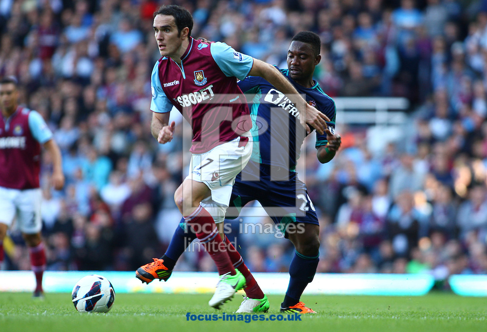 Picture by Rob Fisher/Focus Images Ltd +44 7545 398891.22/09/2012.Matt Jarvis of West Ham United gets away from Sessegnon of Sunderland during the Barclays Premier League match at the Boleyn Ground, London.