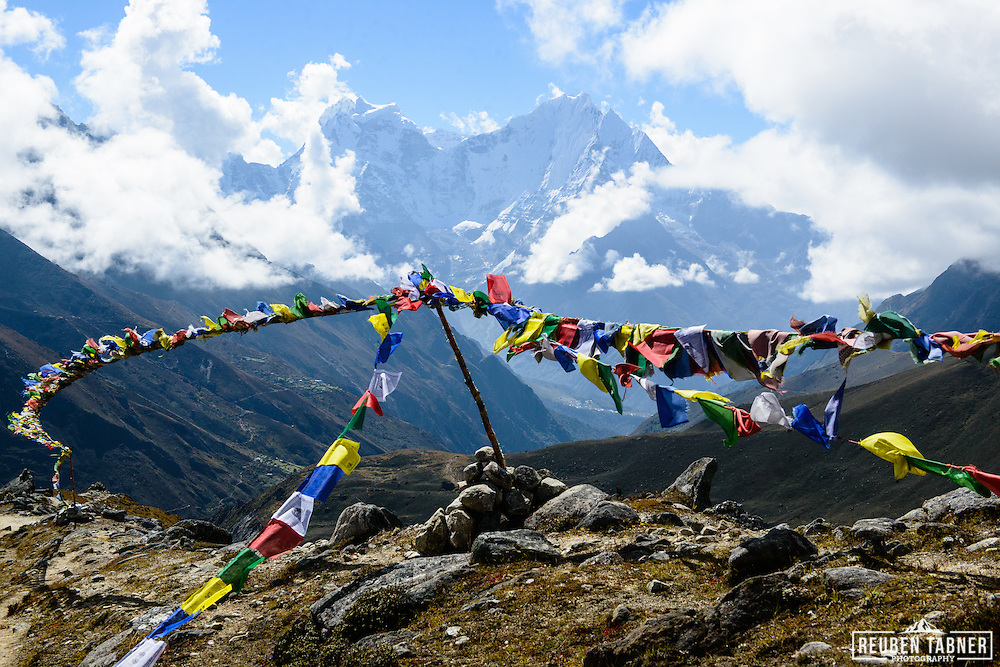 Preyer flags flutter in the wind above the village of Machermo in the Sagarmatha National Park, Nepal.