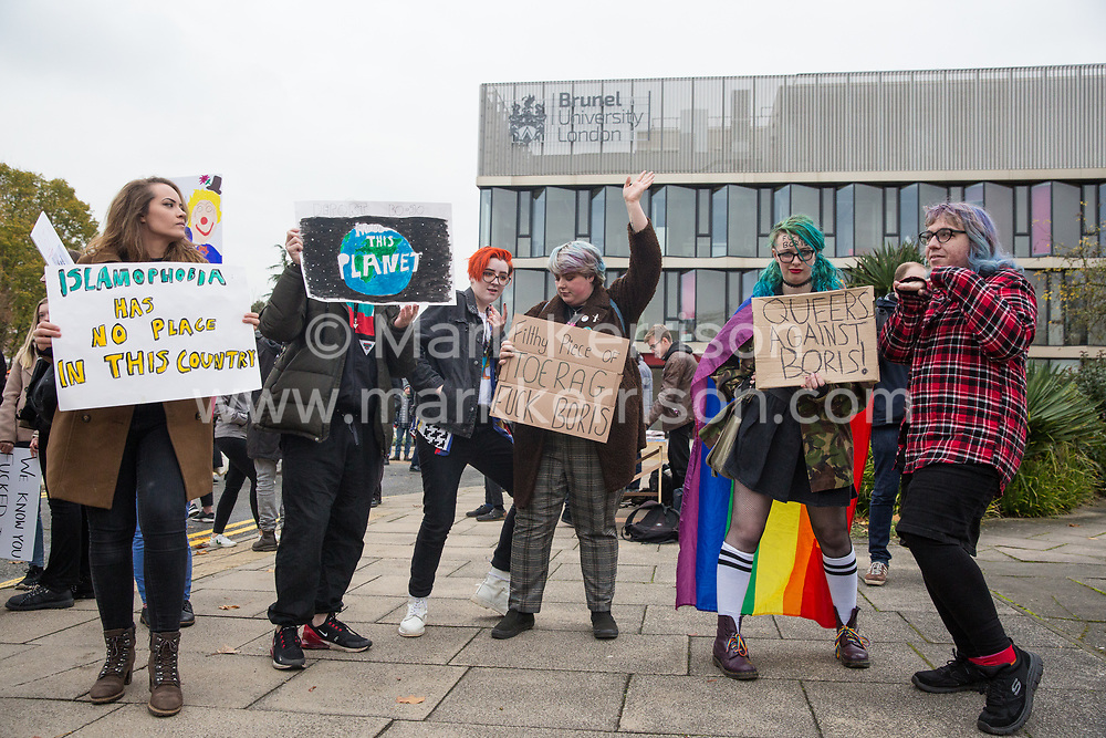 Uxbridge, UK. 16 November, 2019. Young LGBT activists from FckBoris hold a Kick Boris Out parade in Prime Minister Boris Johnson's constituency of Uxbridge and South Ruislip with aim of urging young, working-class and ethnic-minority voters to register to vote in the forthcoming general election whilst also protesting against the timing of an election during a vacation period which makes it difficult for university students to vote.