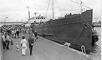Sightseers at Carrickfergus Harbour, N Ireland, to see the departure of the UVF gun-running ship, Clyde Valley, to the breaker's yard. NI Troubles. Ref: 197408022<br /> <br /> Copyright Image from Victor Patterson, Belfast, UK<br /> <br /> t: +44 28 9066 1296 (from Rep of Ireland 048 9066 1296)<br /> m: +44 7802 353836<br /> e: victorpattersonbelfast@gmail.com<br /> <br /> www.images4media.com<br /> <br /> Please see my full Terms and Conditions of Use at https://www.images4media.com/p/terms-conditions - it is IMPORTANT that you familiarise yourself with them.<br /> <br /> Images used online incur an additional cost. This cost should be agreed in writing in advance. Online images must be visibly watermarked i.e. © Victor Patterson or that of the named photographer within the body of the image. The original metadata must not be deleted from images used online.<br /> <br /> This image is only available for the use of the download recipient i.e. television station, newspaper, magazine, book publisher, etc, and must not be passed on to a third party. It is also downloaded on condition that each and every usage is notified within 7 days to victorpattersonbelfast@gmail.com.<br /> <br /> The right of Victor Patterson (or the named photographer) to be identified as the author is asserted in accordance with The Copyright Designs And Patents Act (1988). All moral rights are asserted.